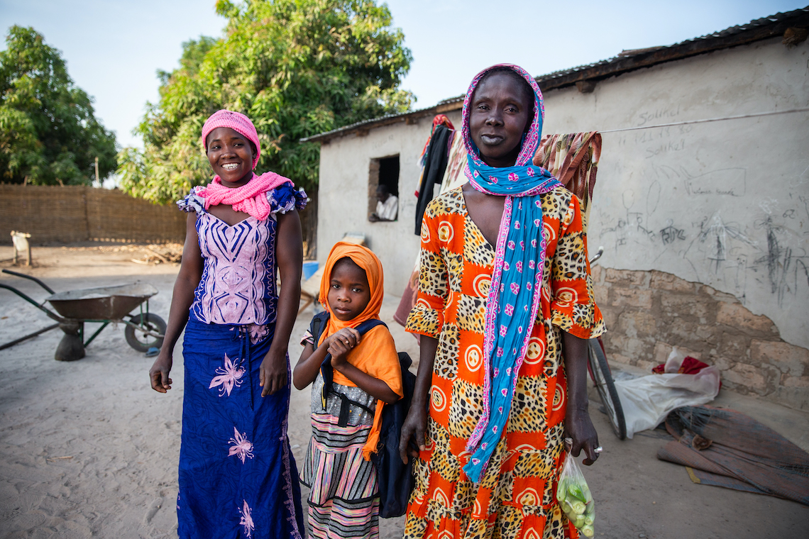 Awa Diao and her mother prepare five-year old Monde for school in Kolda, Senegal. By Natalia Mroz, Nutrition International