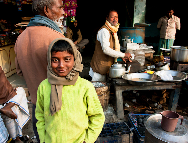 Boy in outdoor Indian cafe